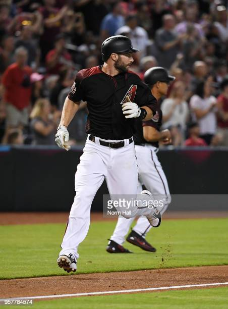 Paul Goldschmidt of the Arizona Diamondbacks rounds third base while looking over his shoulder and scores on a double by teammate AJ Pollock during...