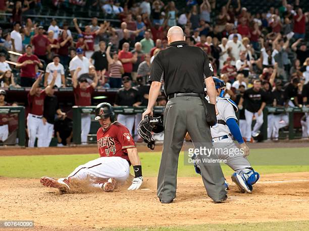 Paul Goldschmidt of the Arizona Diamondbacks scores the winning run in the 12th inning against the Los Angeles Dodgers during the MLB game at Chase...