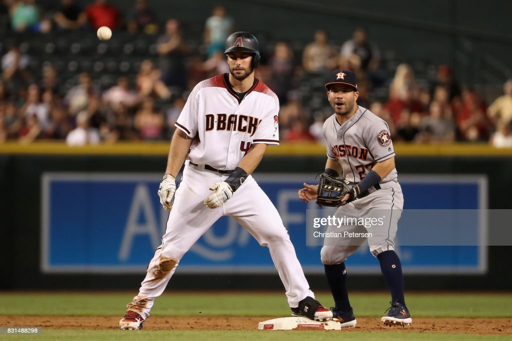 Paul Goldschmidt #44 of the Arizona Diamondbacks stands on second base ahead of infielder Jose Altuve #27 of the Houston Astros after hitting a double during the sixth inning of the MLB game at Chase Field on August 14, 2017 in Phoenix, Arizona.