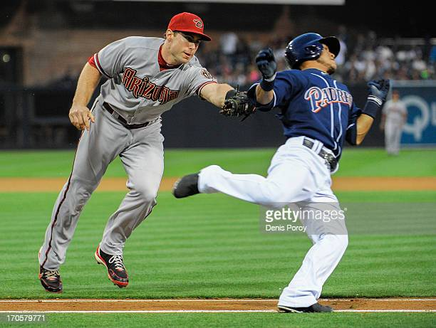 Paul Goldschmidt of the Arizona Diamondbacks tags out Alexi Amarista of the San Diego Padres on the first base line during the third inning of a...