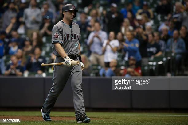 Paul Goldschmidt of the Arizona Diamondbacks walks back to the dugout after striking out in the ninth inning against the Milwaukee Brewers at Miller...