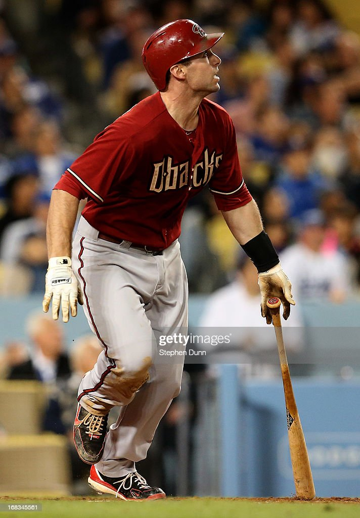Paul Goldschmidt #44 of the Arizona Diamondbacks watches his second home run of the game against the Los Angeles Dodgersto give the Diamodnbacks a one run lead in the eighth inning at Dodger Stadium on May 8, 2013 in Los Angeles, California.