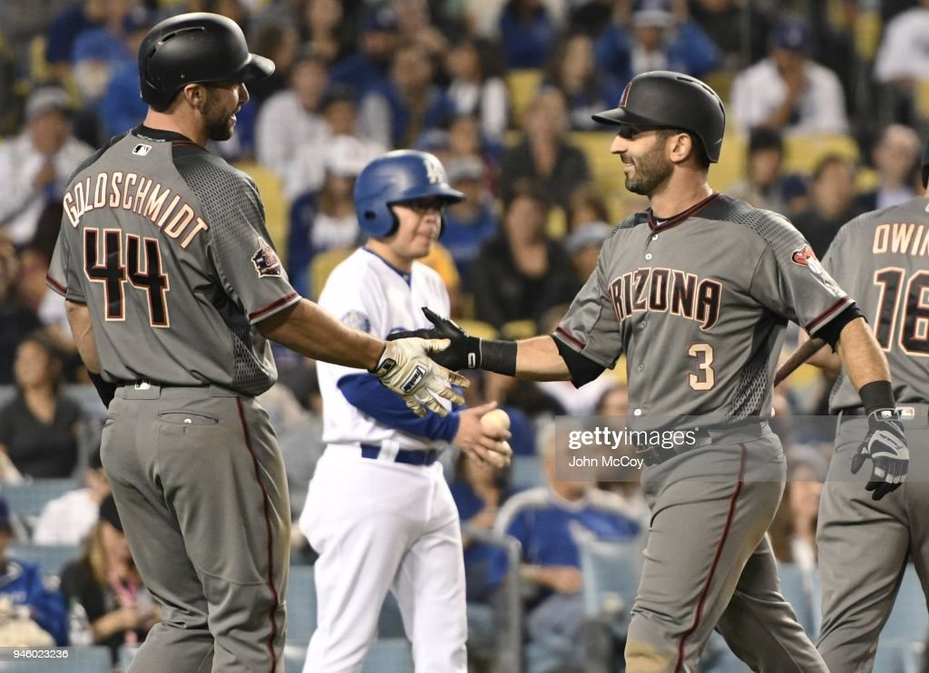 Paul Goldschmidt #44 of the Arizona Diamondbacks welcomes Daniel Descalso #3 home after Descaiso hit a 2 run homer in the 7th inning against the Los Angeles Dodgers at Dodger Stadium on April 13, 2018 in Los Angeles, California.