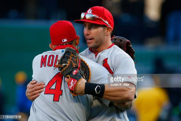 Paul Goldschmidt of the St. Louis Cardinals and Yadier Molina of the St. Louis Cardinals celebrate after defeating the Pittsburgh Pirates in extra...