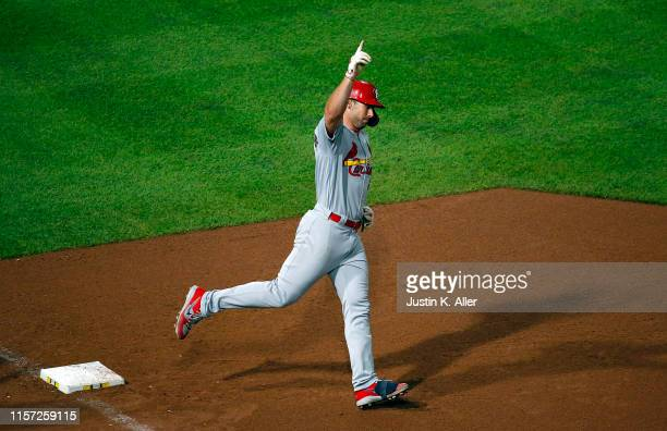 Paul Goldschmidt of the St. Louis Cardinals celebrates after hitting a grand slam home run in the tenth inning against the Pittsburgh Pirates at PNC...