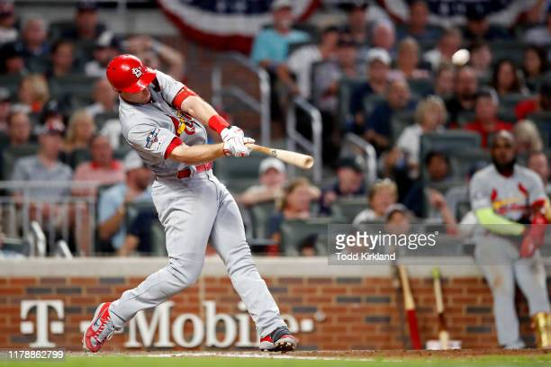 Paul Goldschmidt of the St. Louis Cardinals hits an eighth inning home run against the Atlanta Braves in game one of the National League Division...