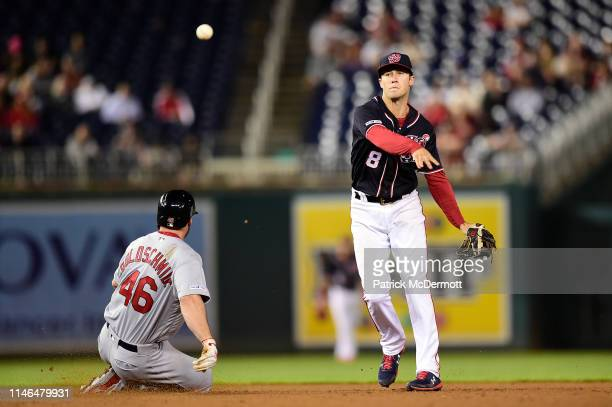 Paul Goldschmidt of the St Louis Cardinals is out at second base as Carter Kieboom of the Washington Nationals turns a double play in the ninth...