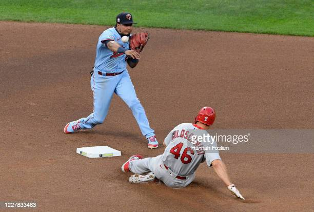 Paul Goldschmidt of the St. Louis Cardinals is out at second base as Luis Arraez of the Minnesota Twins attempts to turns a double play during the...