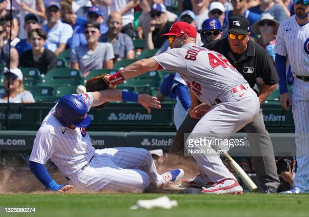 Paul Goldschmidt of the St. Louis Cardinals is unable to pick off Ian Happ of the Chicago Cubs during the fifth inning of a game at Wrigley Field on...