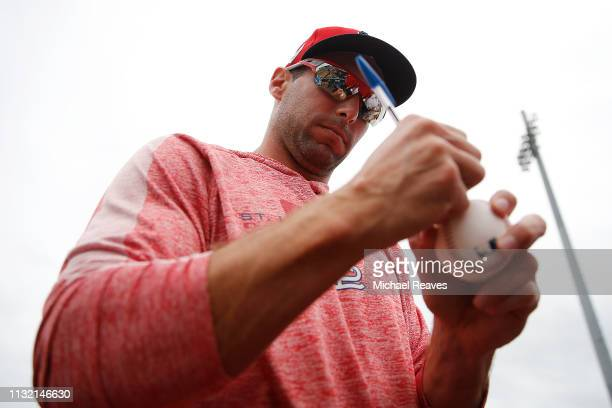 Paul Goldschmidt of the St Louis Cardinals signs autographs for fans prior to the Grapefruit League spring training game against the Detroit Tigers...
