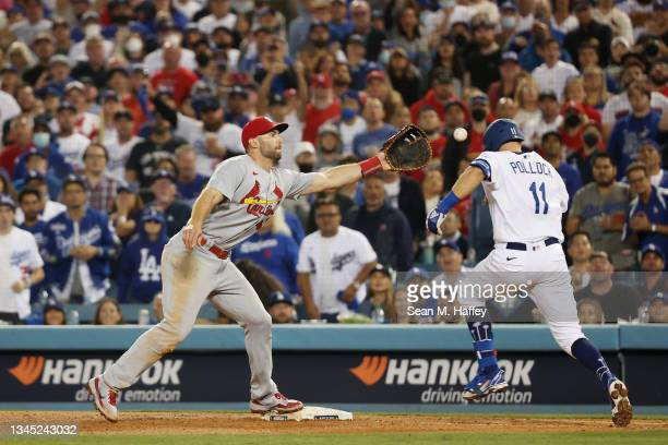 Paul Goldschmidt of the St. Louis Cardinals tags out AJ Pollock of the Los Angeles Dodgers on a ground ball to end the sixth inning during the...