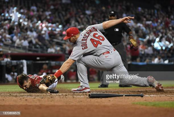 Paul Goldschmidt of the St Louis Cardinals tags out Tim Locastro of the Arizona Diamondbacks as he slides into home plate during the sixth inning at...