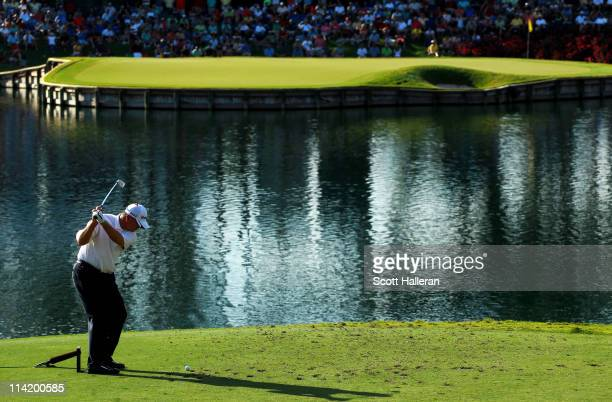 Paul Goydos hits his tee shot on the 17th hole during the final round of THE PLAYERS Championship held at THE PLAYERS Stadium course at TPC Sawgrass...
