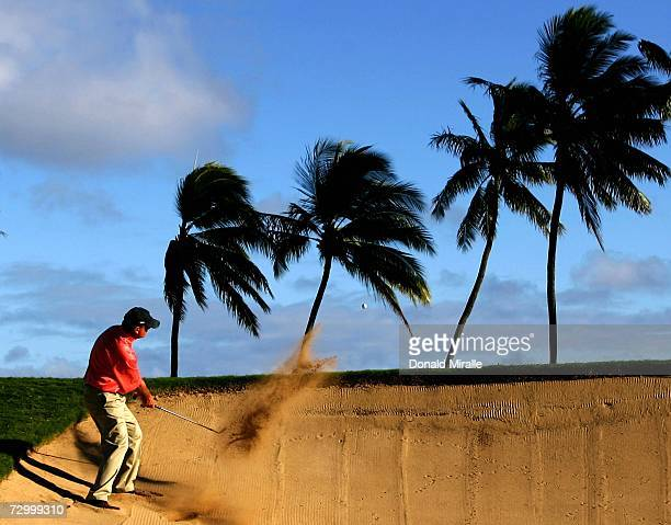 Paul Goydos hits out of the 17th green bunker en route to his 14under par victory during the final round of the Sony Open on January 14 2007 at...
