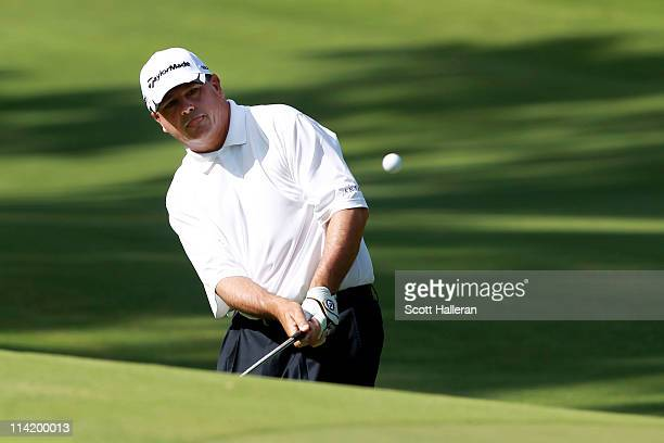 Paul Goydos pitches to the 14th green during the final round of THE PLAYERS Championship held at THE PLAYERS Stadium course at TPC Sawgrass on May 15...