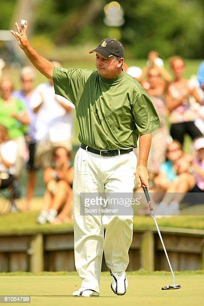 Paul Goydos reacts to a birdie on the 4th hole during the final round of THE PLAYERS Championship on THE PLAYERS Stadium Course at TPC Sawgrass on...