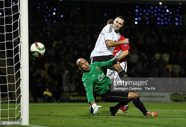 Paul Graf of Germany scores the winning goal during the match between British Army Men and German Bundeswher Men on November 16, 2016 in...