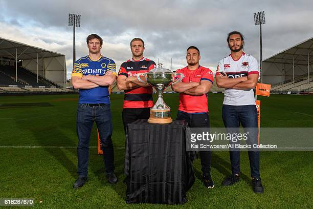 Paul Grant of Otago Luke Whitelock of Canterbury Kane Hames of Tasman and Chris Vui of North Harbour pose with the Rugby Cup during a Mitre 10 Cup...