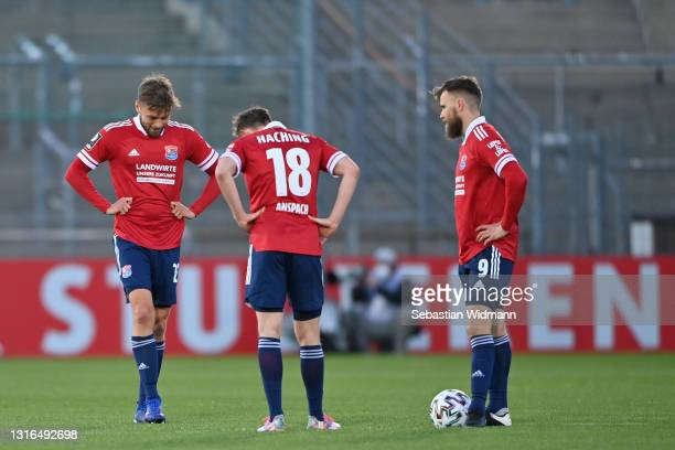 Paul Grauschopf, Niclas Anspach and Stephan Hain of Unterhaching react after receiving their second goal during the 3. Liga match between SpVgg...