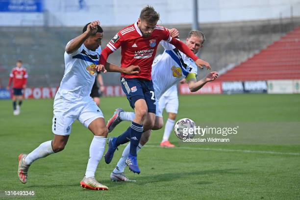 Paul Grauschopfof Unterhaching and Anton-Leander Donkor and Marcel Seegert of SV Waldhof Mannheim compete for the ball during the 3. Liga match...