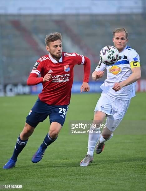 Paul Grauschopfof Unterhaching and Marcel Seegert of SV Waldhof Mannheim compete for the ball during the 3. Liga match between SpVgg Unterhaching...