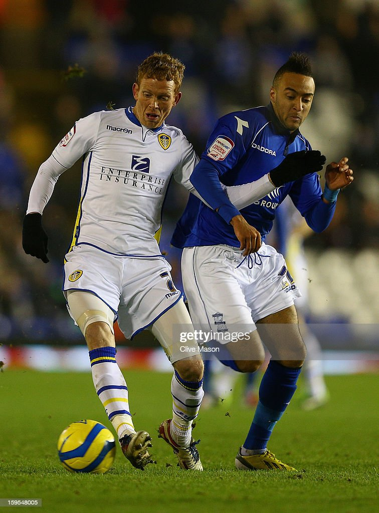 Paul Green of Leeds united is tackled by Nathan Redmond of Birmingham City during the FA Cup with Budweiser Third Round Replay match between Birmingham City and Leeds United at St Andrews on January 15, 2013 in Birmingham, England.