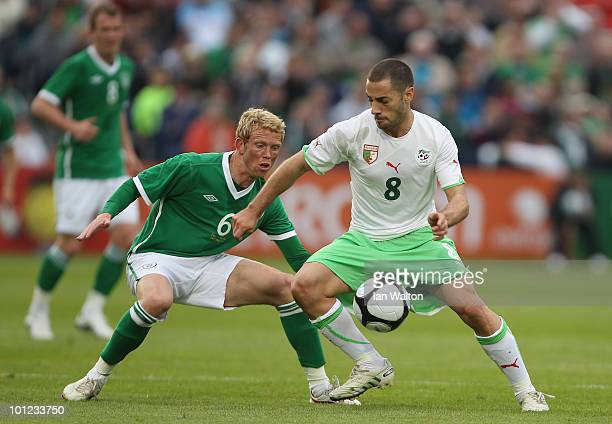 Paul Green of Republic of Ireland tries to tackle Mehdi Lacen during the International Friendly match between Republic of Ireland and Algeria at the...