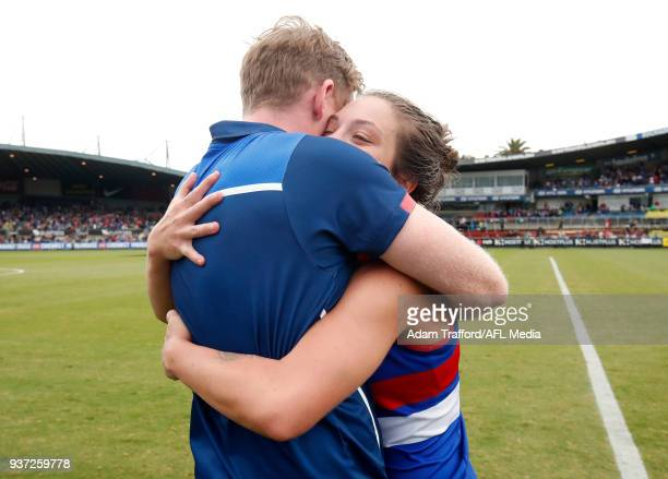 Paul Groves Senior Coach of the Bulldogs celebrates with acting captain Ellie Blackburn of the Bulldogs during the 2018 AFLW Grand Final match...