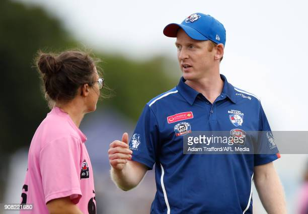 Paul Groves Senior Coach of the Bulldogs chats to Emma Kearney of the Bulldogs during the 2018 AFLW Practice match between the Western Bulldogs and...