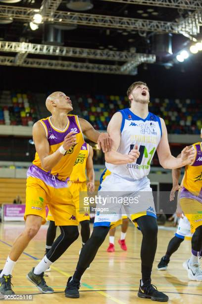 Paul Guede of London Lions and James Gettys of Cheshire Phoenix look on during the British Basketball League match between London Lions and Cheshire...