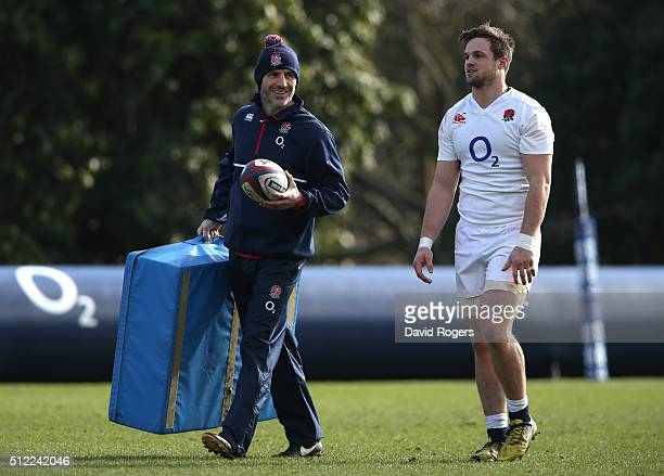 Paul Gustard the England defence coach looks on with Jack Clifford during the England training session held at Pennyhill Park on February 25 2016 in...