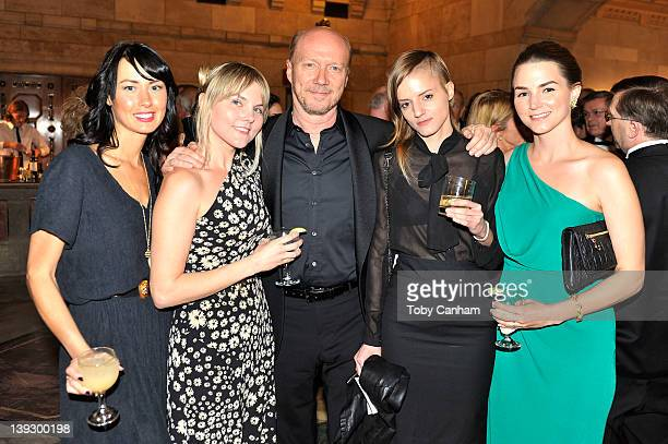 Paul Haggis and pose with his girlfriend and daughters Alissa Haggis Katy Haggis and Lauren Haggis at the 24th Annual Scripter Literary Achievement...