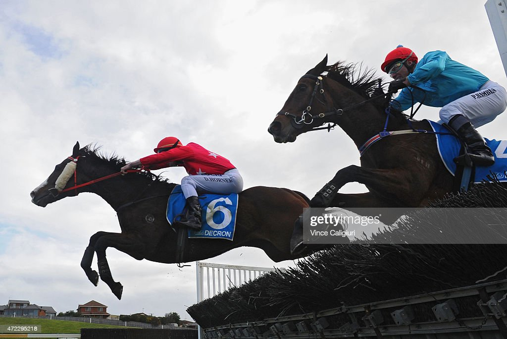 Paul Hamblin riding Stand To Gain (r) jumps the last jump before defeating Darryl Horner (jnr) riding Zuhayr in Race 6, the Sovereign Resort Galleywood during Galleywood Day at Warrnambool Racing Club on May 6, 2015 in Warrnambool, Australia.