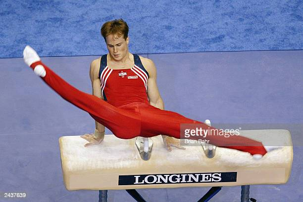 Paul Hamm of the United States competes on the pommel horse during the Men's Individual AllAround Final at the 2003 World Gymnastics Championships at...