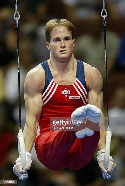 Paul Hamm of the US performs on the rings on his way to winning gold at men individual allaround final of the World Championships Artistic Gymnastics...