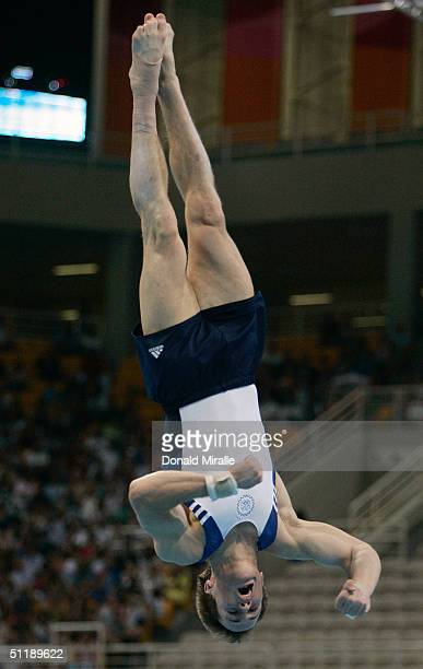 Paul Hamm of the USA competes in the floor exercises at the men's artistic gymnastics individual competition on August 18 2004 during the Athens 2004...