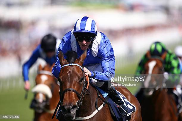 Paul Hanagan ridding Taghrooda celebrates on the line as they win The Investec Oaks at Epsom racecourse on June 06 2014 in Epsom England
