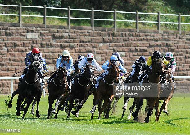Paul Hanagan riding Doctor Parkes turn into the straight to win The Stellar Group Handicap Stakes at Chester racecourse on May 04 2011 in Chester...