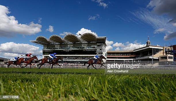 Paul Hanagan riding Mustajeer win The NGK Spark PLug EBF Stallions Maiden Stakes at Newmarket racecourse on September 24 2015 in Newmarket England