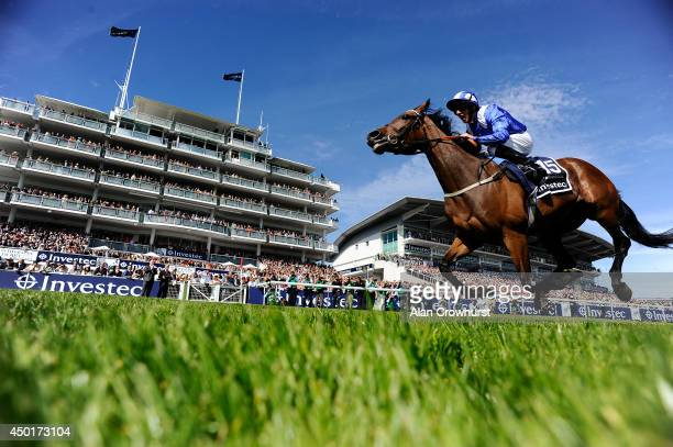 Paul Hanagan riding Taghrooda win The Investec Oaks at Epsom racecourse on June 06 2014 in Epsom England