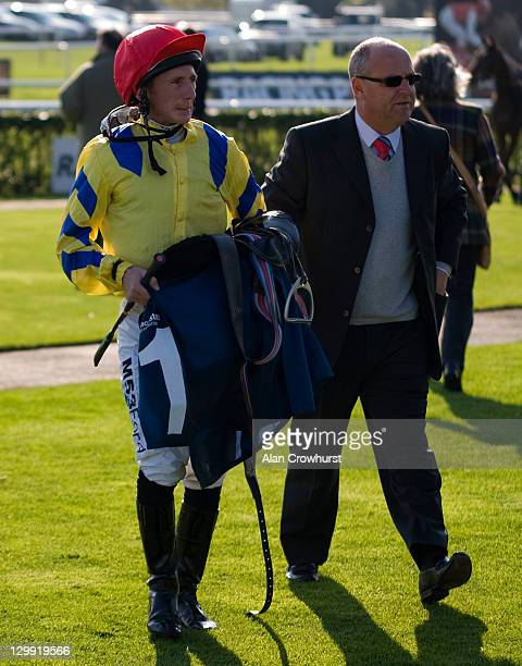 Paul Hanagan with trainer Richard Fahey at Doncaster racecourse on October 22 2011 in Doncaster England