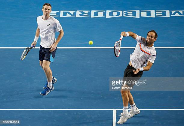 Paul Hanley of Australia and Jonathan Marray of Great Britain in action in their first round doubles match against Bob Bryan of the United States and...