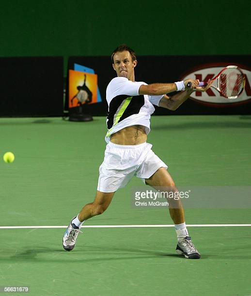 Paul Hanley of South Africa his a forehand in his doubles match with Kevin Ullyett of South Africa against Jeff Coetzee of South Africa and Rogier...