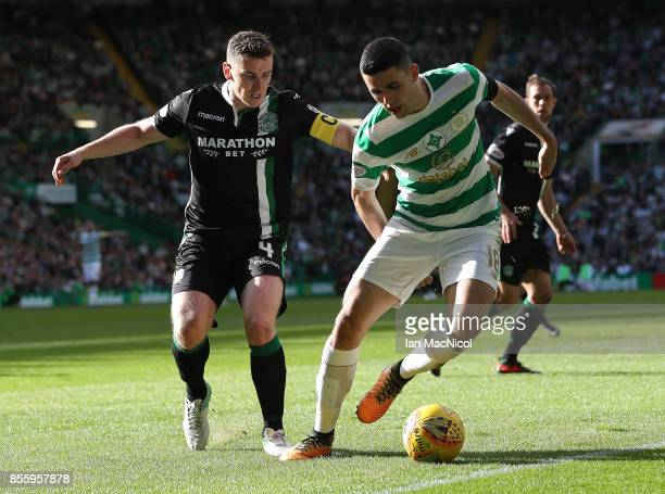 Paul Hanlon of Hibernian vies with Tomas Rogic of Celtic during the Ladbrokes Scottish Premiership match between Celtic and Hibernian at Celtic Park...