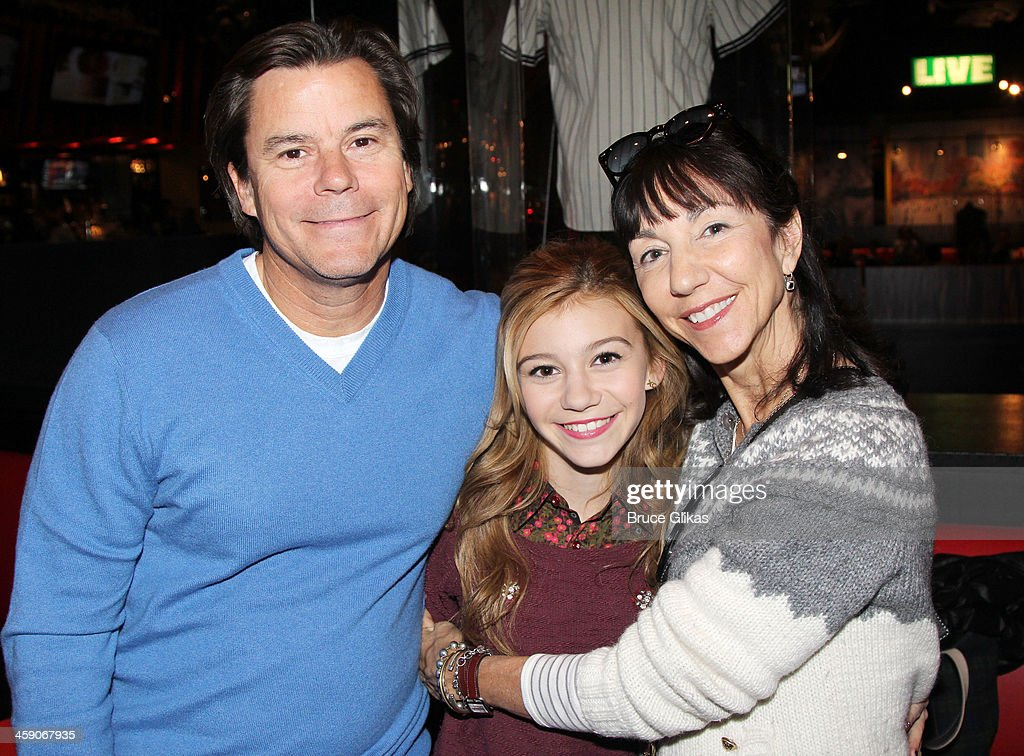 Paul Hannelius, daughter G. Hannelius of Disney's Dog with a Blog and mother Kathy Hannelius visit Planet Hollywood Times Square on December 22, 2013 in New York City.