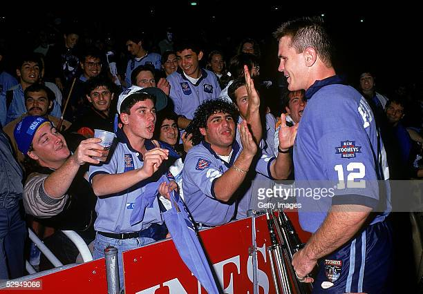 Paul Harragon of the Blues celebrates with fans after winning the match and the series during the NSWRL State of Origin match between the New South...