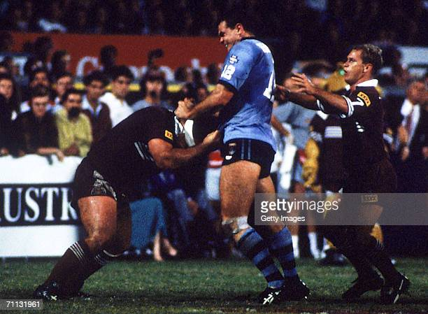 Paul Harragon of the Blues picks a fight with Martin Bella of the Maroons during the NSWRL State of Origin game three match between the Queensland...