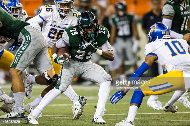 Paul Harris of the Hawaii Warriors carries the ball against the San Jose State Spartans during the second quarter of a college football game at Aloha...