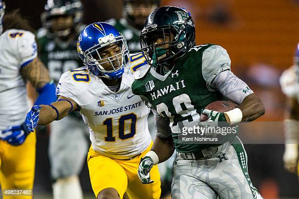 Paul Harris of the Hawaii Warriors carries the ball against the San Jose State Spartans during the second half of a college football game at Aloha...