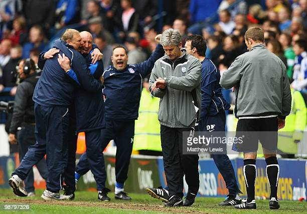 Paul Hart, manager of Crystal Palace celebrates after his team avoided relegation following a draw as Sheffield Wednesday manager Alan Irvine watches...